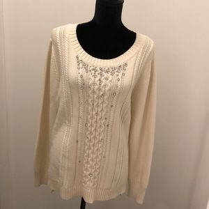Off white sweater with silver rhinestones.